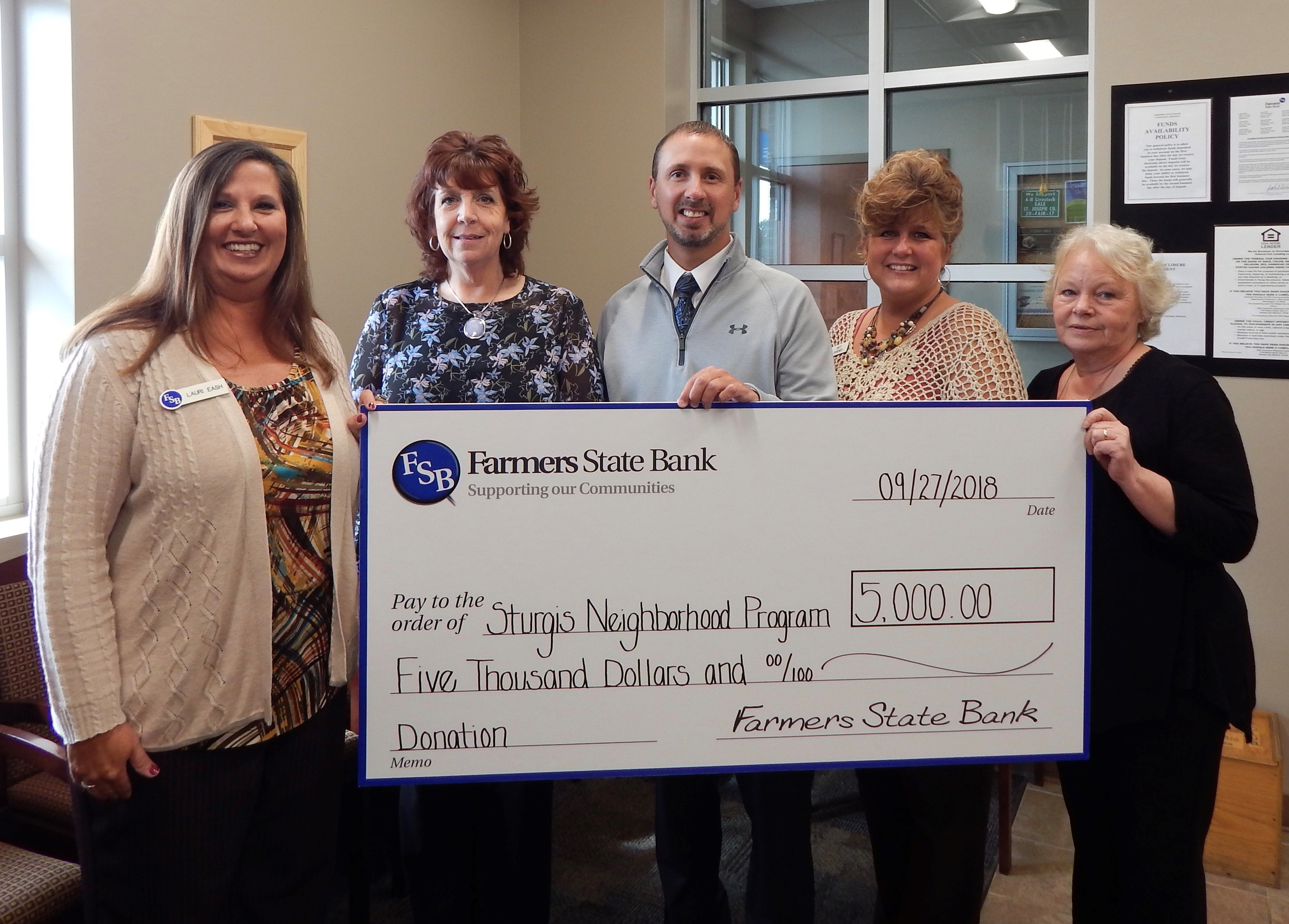 FSB donation picture to Sturgis Neighborhood Program in 2018