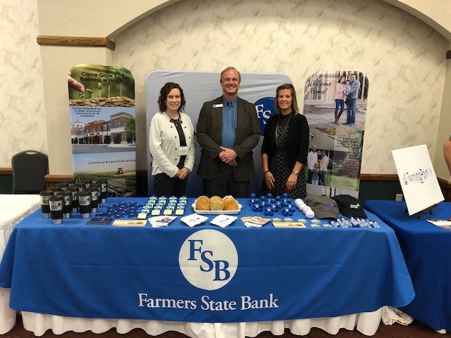Employees with booth at Angola chamber luncheon and expo October 2018